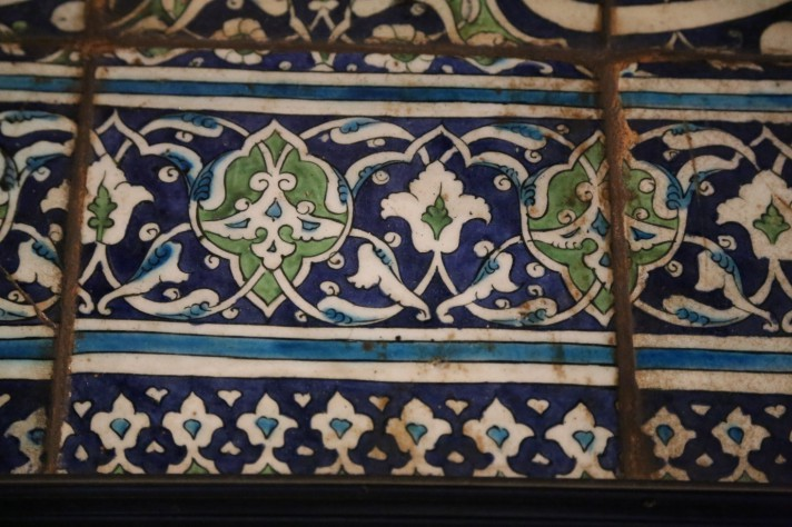 Detail of blue, white and green Damascus tiles with a foliate design