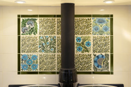 Large foliate and floral tiles, predominantly blue and green in colour.