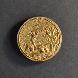 Reverse of a round medal showing the biblical scene of David defeating Goliath, with the two protagonists in the foreground, and many smaller figures behind