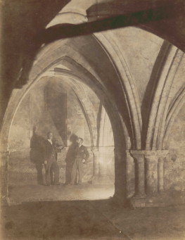 Black and white photograph of Henry Fincham in the Crypt of the Priory Church