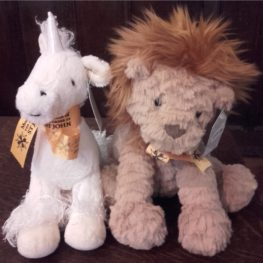 "ALT=""cuddly toy unicorn and lion sat together on table"""