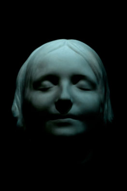 "ALT=""white porcelain mask of a young female face with a peaceful expression"""