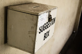 An image of a suggestion box. Author: Hash Milhan. Wikimedia Commons