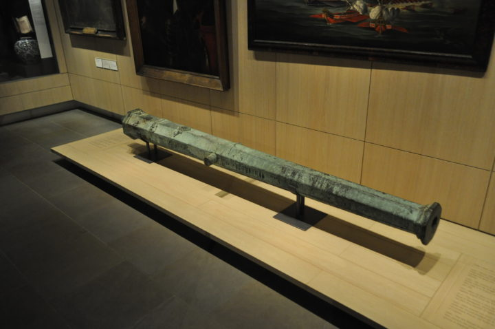 a cannon in a museum gallery