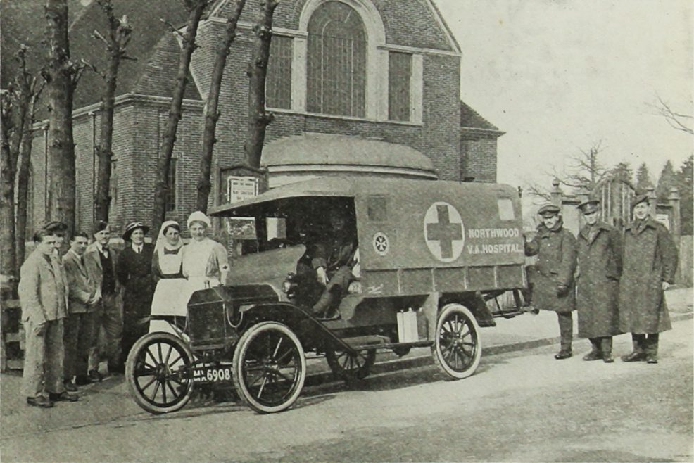 The presentation of a Ford Ambulance Car to be stationed at the VAD Hospital Northwood. Mrs Darlow is fifth from the left.