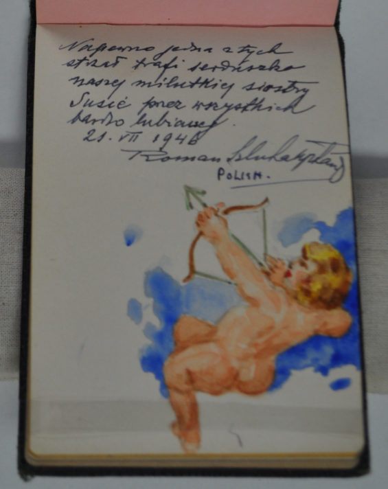 Page in autograph notebook with a small message written in Polish and a watercolour painting of a naked cupid firing a bow and arrow upwards.