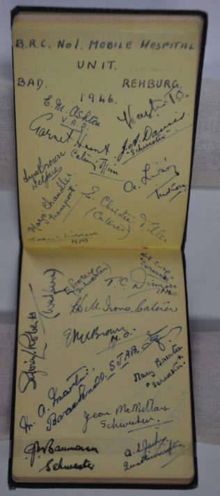 Two page spread in autograph notebook full of signatures.