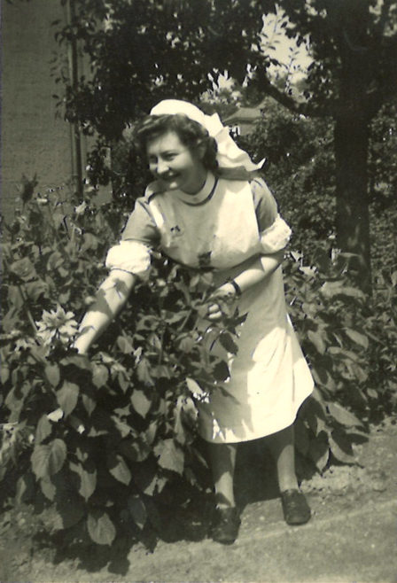 Susie in the garden of Montgomery Hospital, Bad Rehburg, Germany. 26th July 1945.