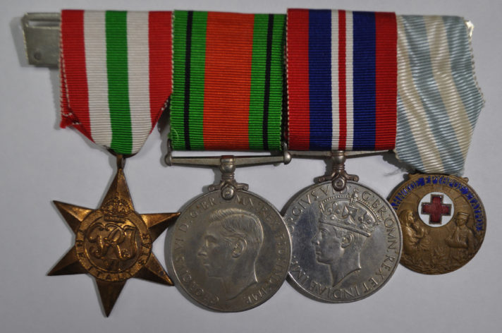 Set of four medals on ribbon mounted together, the obverse side. One copper star shaped medal, two silver round shaped medals and one bronze smaller round shaped medal with red cross enamel detail.