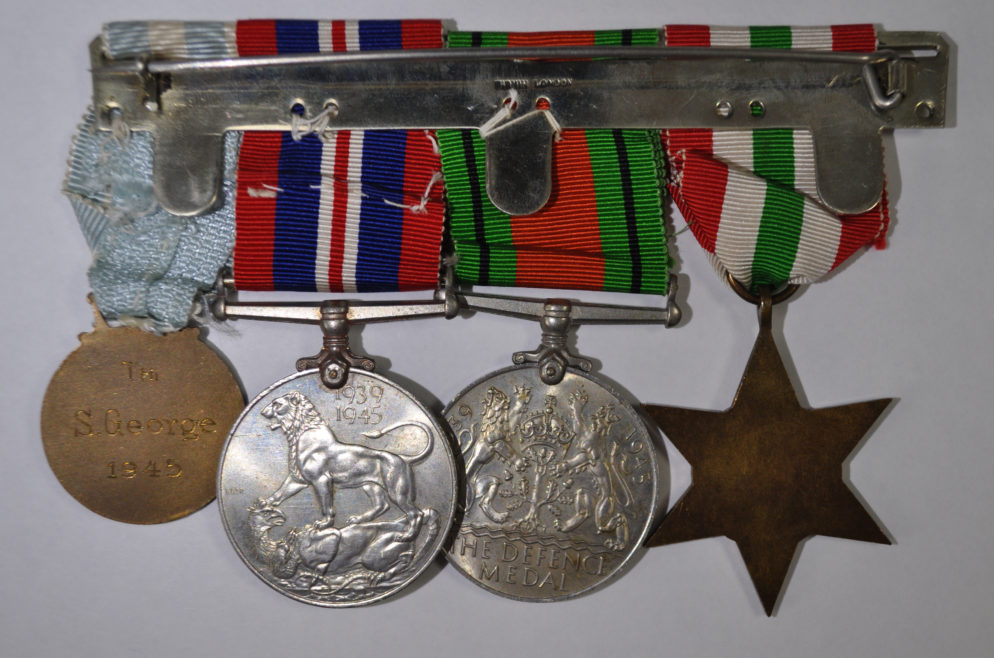 Susie's medal set: Bronze Greek Red Cross Medal, War Medal 1939-45, Defence Medal, Italy Star.