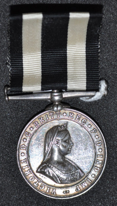 Round Silver coloured Medal with portrait bust of Queen Victoria.
