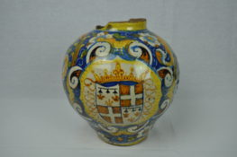 A large round jar, colourfully painted.