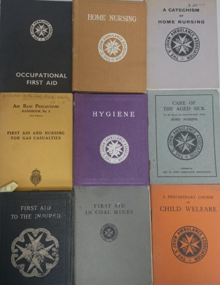 Photograph of nine different first aid manuals