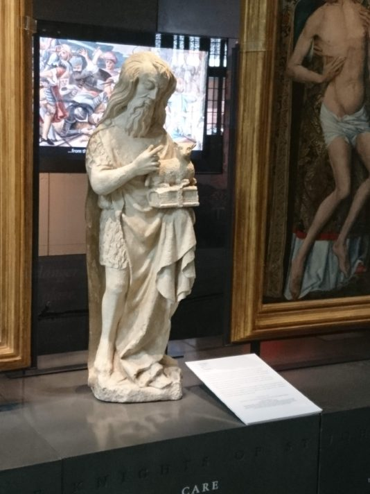 Statue of St John the Baptist holding the lamb of god on a book