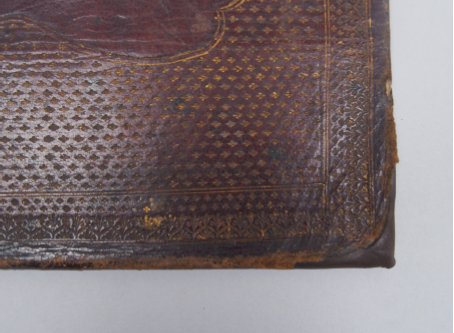 After treatment - the leather bindings now cover the boards beneath at the damaged corners.